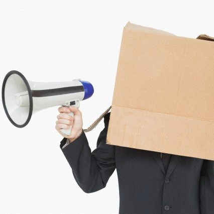 17 Apr 2014 --- Businessman with box on head holding megaphone --- Image by © Wavebreak Media LTD/Wavebreak Media Ltd./Corbis