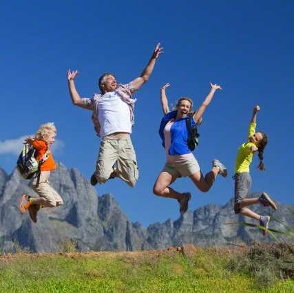 17 Nov 2014, Cape Town, South Africa --- Family jumping in the air on a mountain hiking trail --- Image by © Graham Oliver/Juice Images/Corbis